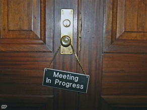 A 'Meeting In Progress' sign hangs on the door of the Senate Appropriations Committee Sunday on Capitol Hill in Washington.