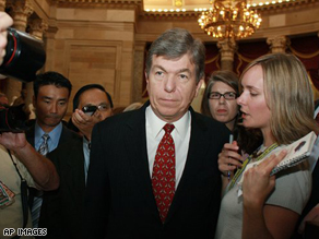 House Republican Whip Roy Blunt, (R), is pursued by reporters after the House voted down the Emergency Economic Stabilization Act of 2008.