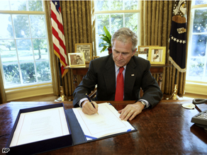 President Bush signs the Emergency Economic Stabilization Act of 2008
