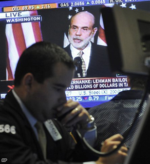 Fed Chairman Ben Bernanke on a television screen on the New York Stock Exchange trading floor.