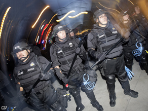 Police officers prepare for protesters during the 2008 Democratic National Convention in Denver.