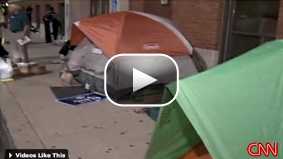 Some Cincinnati, Ohio voters camp out overnight in order to be one of the first to cast their ballot early.