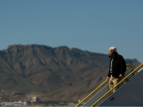 Sen. McCain got off his plane Saturday with the hills of Mexico in the background on his way to a campaign stop in New Mexico.