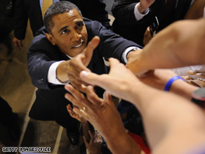Sen. Obama reaches up to greet eager supporters last week in Richmond, Virginia. Obama is scheduled to be in Virginia again Tuesday.