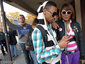 Antoine Owens-Davis, 19, and D'nise Smith, 18, wait to vote for the first time in Philadelphia, Pennsylvania.