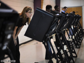Wendy Bolton studies the ballot as she votes at First Ward Elementary School in Charlotte, NC.