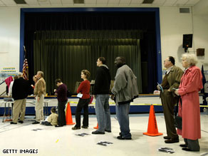 Voters wait in line to cast their ballots at Lyles Crouch School on Election Day November 4, 2008 in Alexandria, Virginia.