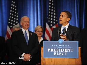 Vice President-elect Biden looks on as the nation's next president gives his first press conference since winning the White House.