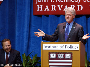 Larry Summers looks on as his former boss, Bill Clinton, speaks.  Summers, who served as treasury secretary under Clinton, is now thought to be among the contenders for the same post under President-elect Obama.