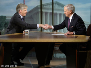 NBC&#039;s David Gregory, left, shakes hands with Tom Brokaw on the set &#039;Meet the Press&#039; Sunday.