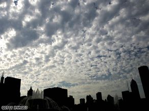 Chicago, once in the glow of Obama's victory, now has a cloud over it, Greene says.