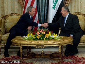 President Bush shakes hands with Iraqi President Jalal Talabani in Baghdad Sunday.