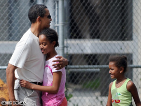Malia and Sasha Obama, pictured here on a recent Hawaiian vacation with the President-elect, traveled to Washington Saturday with Mrs. Obama.