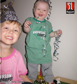 Zachary Wand, 3, and his younger brother Carter, 1, at a New Year's Eve party at home in Ontario, Canada.