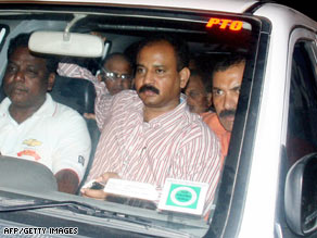 Satyam founder B. Ramalinga Raju is shown Saturday being sent to prison in Hyderabad.