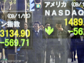 Businessmen are reflected on a share prices board in Tokyo, Japan, on Thursday.