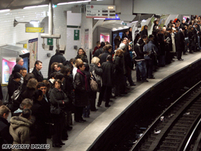 "Commuters wait for a train at a metro station in central Paris on ""Black Thursday."""