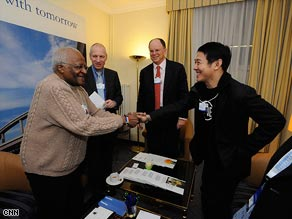 Archbishop Desmond Tutu, CNN's Charles Hodson, Deloitte CEO James Quigley and Jet Li in Davos
