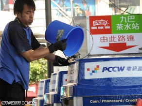 A worker cleans a PCCW telephone booth in January in Hong Kong, China.