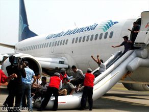 People posing as passengers take part in an anti-terrorist drill at Sukarno-Hatta airport in Jakarta.