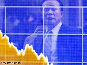 A businessman stares at a board showing share prices in Tokyo on Wednesday.