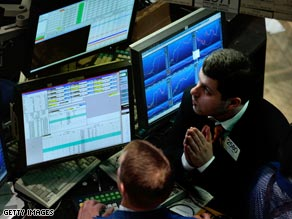 A trader watches the market moves on the floor of the New York Stock Exchange.