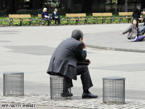 A businessman sits on an improvised chair at a Tokyo park on Tuesday.