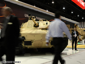 Visitors walk past a BAE Systems infantry vehicle at a recent exhibition in Abu Dhabi.