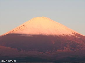 Mount Fuji glows red in the sunset, much like the year-end results of Japanese manufacturers.
