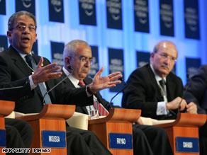 Arab League Secretary-General Amre Moussa, left, gestures at the World Economic Forum.