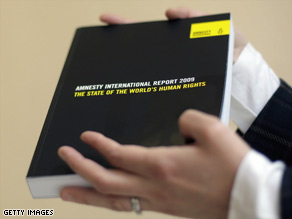The Amnesty International Report 2009 is pictured in central London.