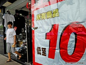 A woman walks out of a store advertising a promotion in Shanghai.