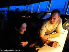 Chief Officer Christian Vium talks to CNN's Eunice Yoon as night falls on the bridge of the Svend.