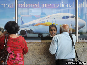 Air travelers wait at the Jet Airways counter at the city airport in Mumbai on Tuesday.