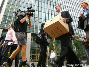 One year ago cameras caught shocked Lehman Brothers' employees leaving the building with boxes.