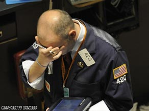 A New York trader reacts to the fall of global stock markets in September 2008.