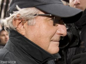 Bernard Madoff strolls down New York's Lexington Avenue after news of the scandal breaks.