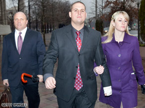 Former Blackwater Worldwide security Donald Ball, center, leaves court after his arraignment Tuesday.