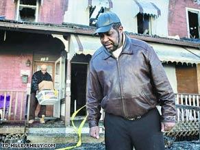 A huge fire spread through more than a dozen homes Sunday outside Philadelphia, authorities said.