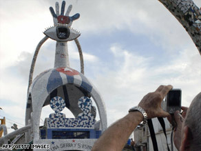 A man takes a picture  in September of a sculpture in honor of the Cuban Five in Havana, Cuba.