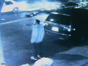 Surveillance video shows a body in the middle of the street.