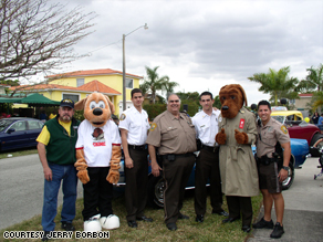 Jerry Borbon, Scruff, McGruff the Crime Dog and police officers at a Westchester neighborhood celebration.