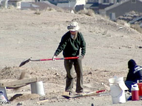 An Albuquerque, New Mexico, police forensics team member digs at the burial site.
