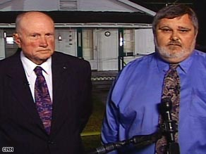 Mayors Wynnton Melton, left, of Geneva, Alabama, and Clay King of Samson, Alabama, speak with CNN.