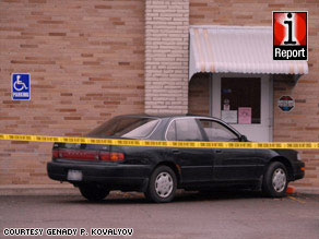 Police say the use of this car to block the back door of the immigration center suggests premeditation.