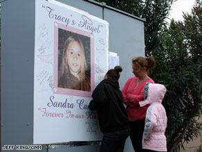 Mourners gather on April 7 in Tracy, California, one day after Sandra Cantu, 8, was found dead.