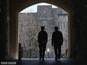 Students walk through a passageway connecting Norris Hall to another building at Virginia Tech.