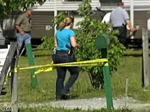 Police examine the scene where a domestic violence suspect engaged in a shootout with deputies.