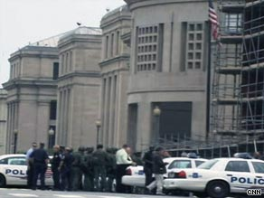 Police cars mass outside the Holocaust Memorial Museum in Washington after a shooting there on Wednesday.