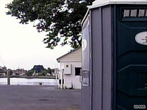 A Maryland woman is charged with child abuse after police say she dropped her newborn into a portable toilet.
